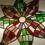 Acht puntige ster glas in lood paneel in paars groene tinten